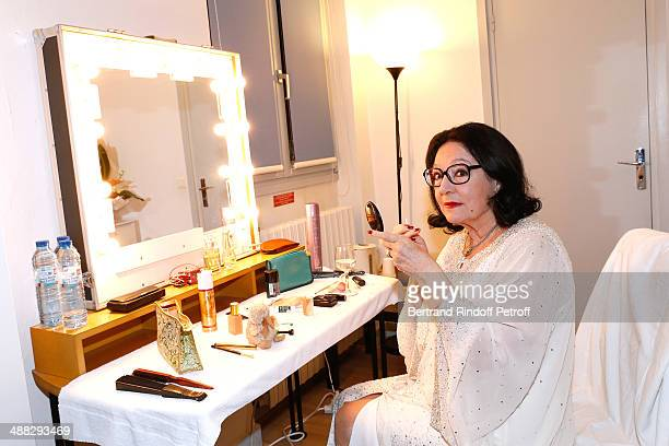 Singer Nana Mouskouri pose backstage before she performs on her Happy Birthday Tour Held at 'Theatre du Chatelet' on March 10 2014 in Paris France