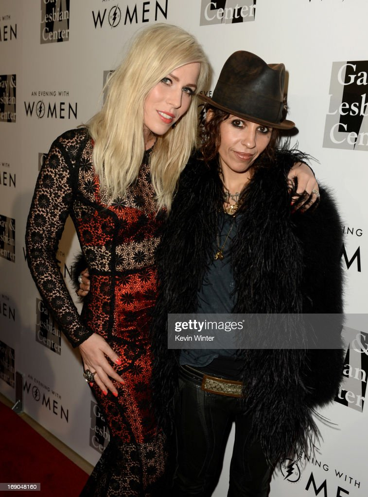 Singer Natasha Bedingfield (L) and musician/producer Linda Perry arrive at An Evening With Women benefiting The L.A. Gay & Lesbian Center at the Beverly Hilton Hotel on May 18, 2013 in Beverly Hills, California.