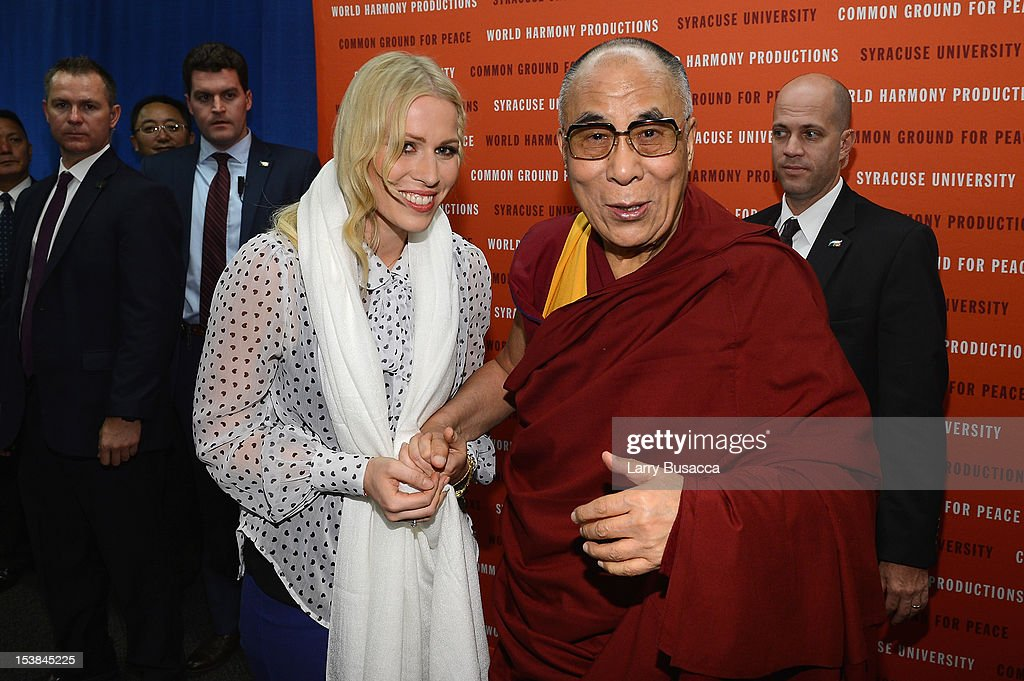 Singer Natasha Bedingfield poses with His Holiness the Dalai Lama at the One World Concert at Syracuse University on October 9 2012 in Syracuse New...