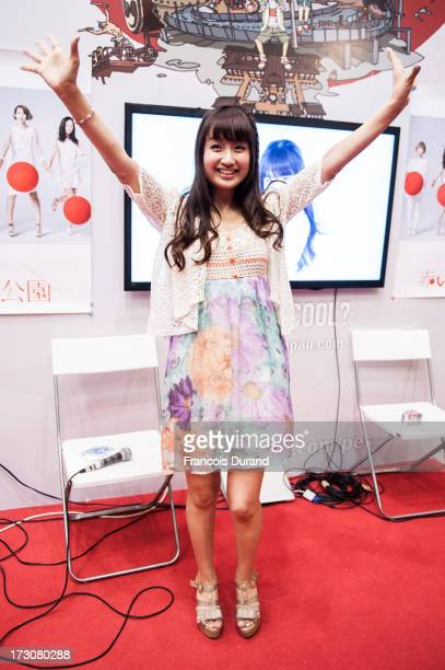 Singer Natsuko Aso attend a talk and autograph session at the 'TOYOTA x STUDIO4AC meets ANA PES' booth during the Japan Expo at Parisnord Villepinte...