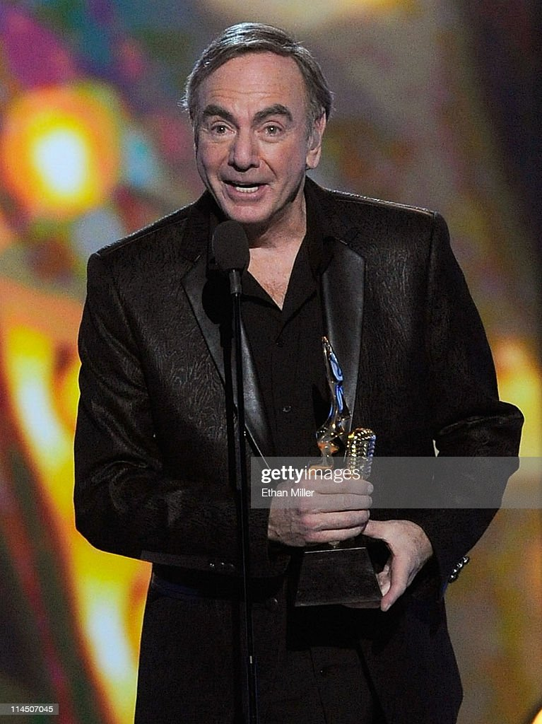 Singer <a gi-track='captionPersonalityLinkClicked' href=/galleries/search?phrase=Neil+Diamond&family=editorial&specificpeople=210635 ng-click='$event.stopPropagation()'>Neil Diamond</a> accepts the Icon Award onstage during the 2011 Billboard Music Awards at the MGM Grand Garden Arena May 22, 2011 in Las Vegas, Nevada.