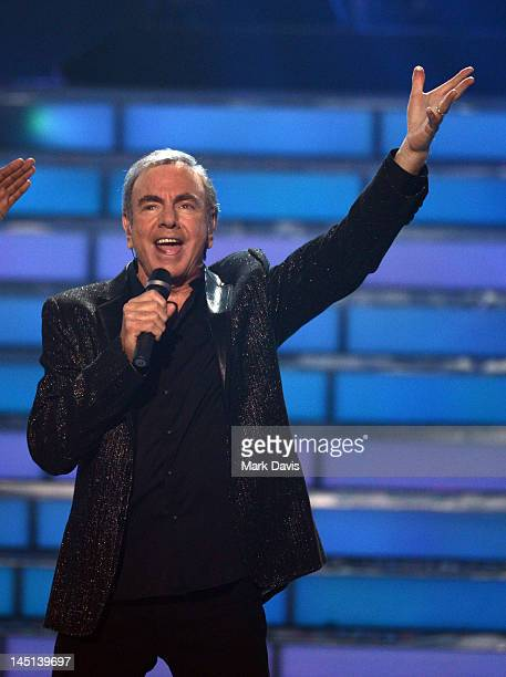 Singer Neil Diamond performs onstage during Fox's 'American Idol 2012' results show at Nokia Theatre LA Live on May 23 2012 in Los Angeles California
