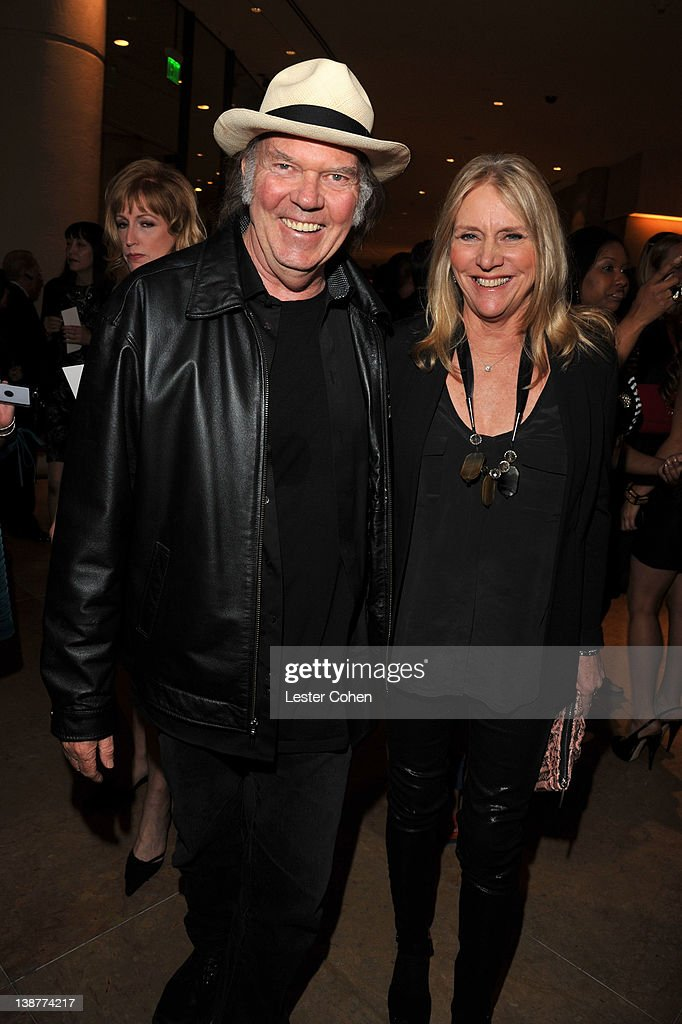 Singer Neil Young (L) and singer Pegi Young arrive at Clive Davis and The Recording Academy's 2012 Pre-GRAMMY Gala and Salute to Industry Icons Honoring Richard Branson at The Beverly Hilton hotel on February 11, 2012 in Beverly Hills, California.
