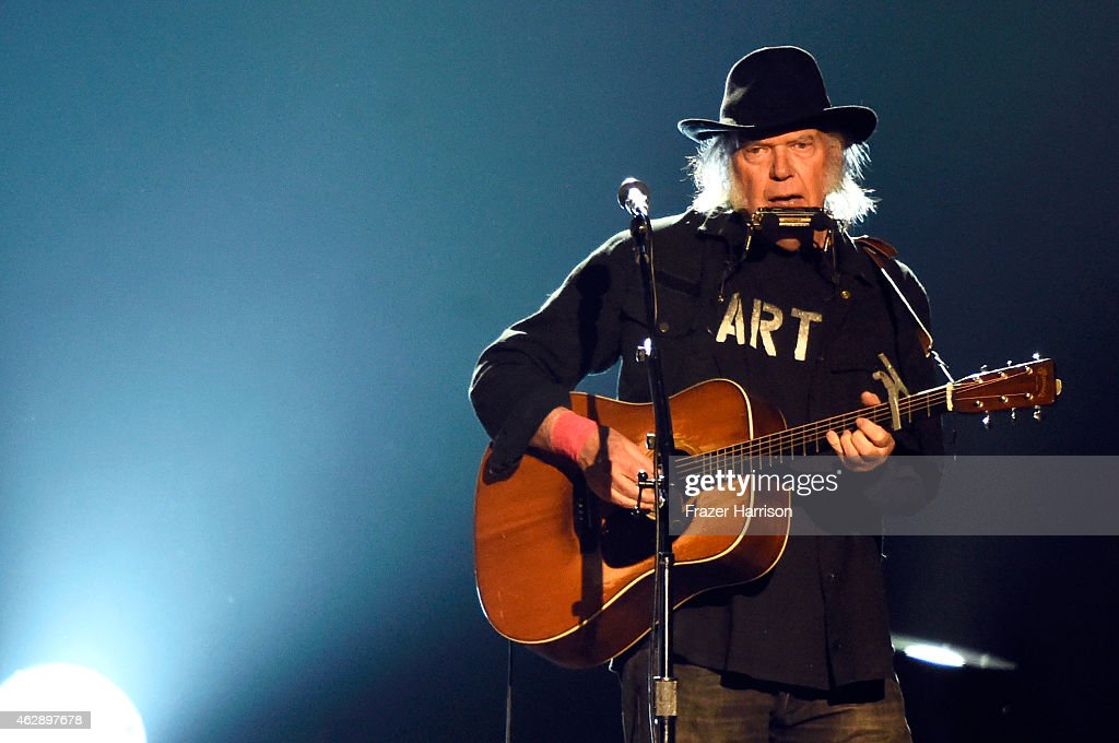 Singer Neil Young performs onstage at the 25th anniversary MusiCares 2015 Person Of The Year Gala honoring Bob Dylan at the Los Angeles Convention Center on February 6, 2015 in Los Angeles, California. The annual benefit raises critical funds for MusiCares' Emergency Financial Assistance and Addiction Recovery programs.