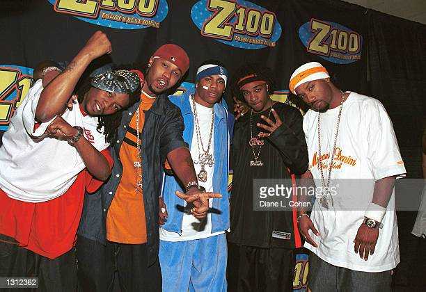 Singer Nelly center and his band pose backstage during Z100''s Zootopia Concert June 1 2001 at the Nassau veteran''s Memorial Coliesium in New York