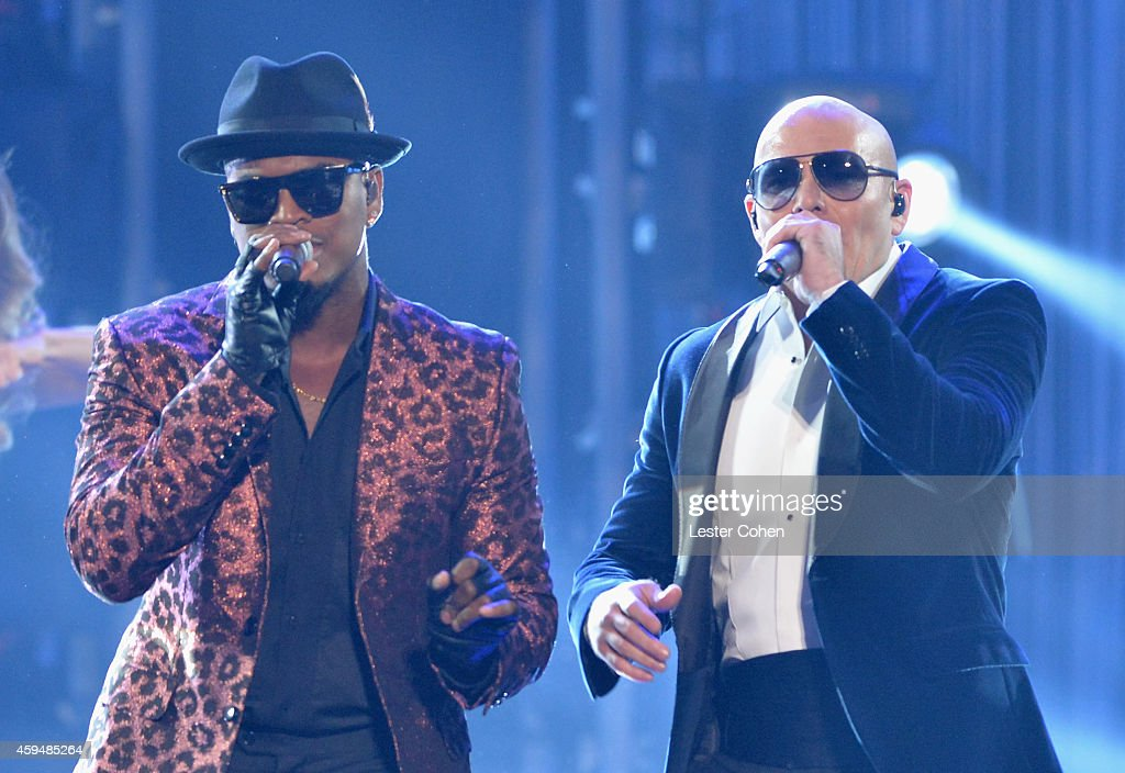 Singer <a gi-track='captionPersonalityLinkClicked' href=/galleries/search?phrase=Ne-Yo&family=editorial&specificpeople=451543 ng-click='$event.stopPropagation()'>Ne-Yo</a> (L) and rapper <a gi-track='captionPersonalityLinkClicked' href=/galleries/search?phrase=Pitbull+-+Rapper&family=editorial&specificpeople=206389 ng-click='$event.stopPropagation()'>Pitbull</a> perform onstage at the 2014 American Music Awards at Nokia Theatre L.A. Live on November 23, 2014 in Los Angeles, California.