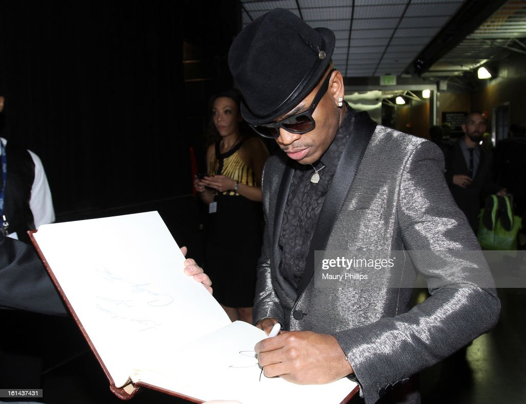 Singer Ne-Yo poses at the GRAMMY Charities Signing Booth during the 55th Annual GRAMMY Awards at STAPLES Center on February 10, 2013 in Los Angeles, California.