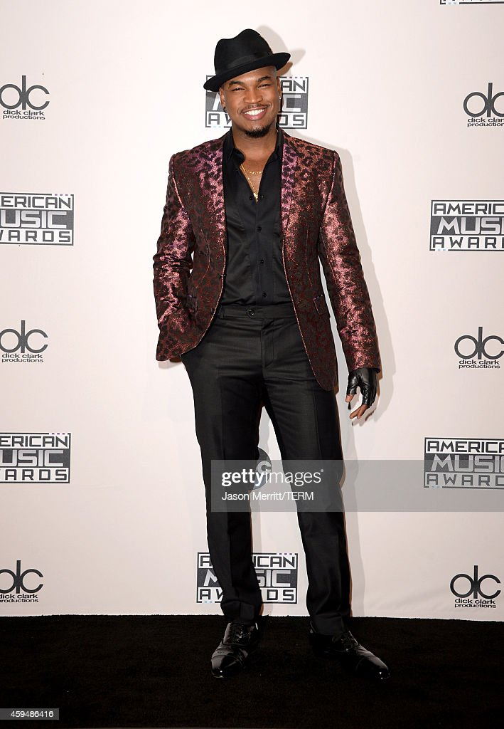 Singer <a gi-track='captionPersonalityLinkClicked' href=/galleries/search?phrase=Ne-Yo&family=editorial&specificpeople=451543 ng-click='$event.stopPropagation()'>Ne-Yo</a> poses in the press room at the 2014 American Music Awards at Nokia Theatre L.A. Live on November 23, 2014 in Los Angeles, California.