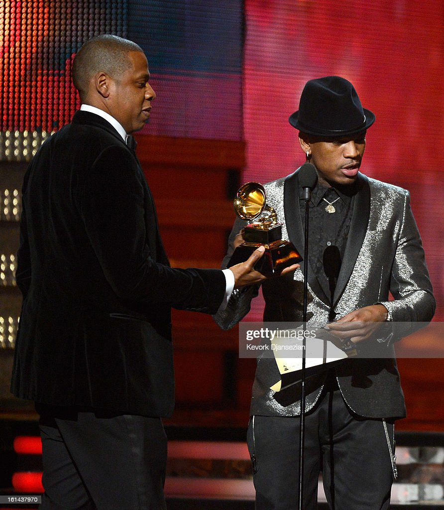 Singer Ne-Yo (R) presents musician Jay-Z the Best Rap/Sung Collaboration award for 'No Church in the Wild' onstage at the 55th Annual GRAMMY Awards at Staples Center on February 10, 2013 in Los Angeles, California.