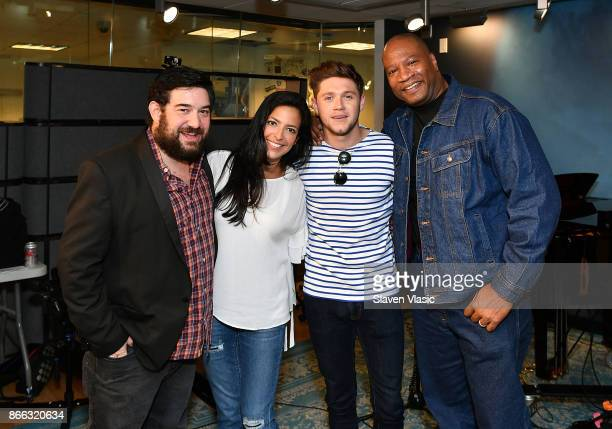 Singer Niall Horan and cohosts of 'The Morning Mash Up' Ryan Sampson Nicole Ryan and Stanley T pose for a photo at 'Hits 1' at SiriusXM Studios on...