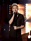 Singer Niall Horan of One Direction performs onstage during the 2015 American Music Awards at Microsoft Theater on November 22 2015 in Los Angeles...