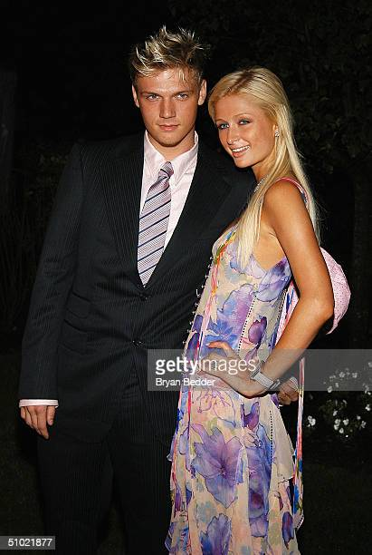 Singer Nick Carter and Paris Hilton arrive to celebrate the launch of her new label 'Heiress Records' at the PlayStation 2 estate July 2 2004 in East...