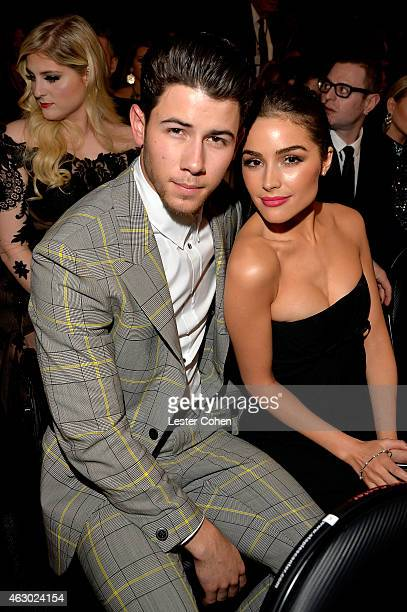 Singer Nick Jonas and actress Olivia Culpo during The 57th Annual GRAMMY Awards at the STAPLES Center on February 8 2015 in Los Angeles California