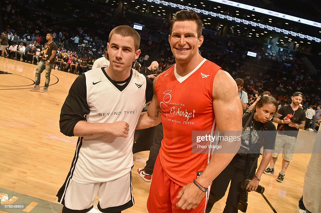 Singer Nick Jonas and football punter Steve Weatherford attend the Roc Nation Summer Classic Charity Basketball Tournament at Barclays Center of...
