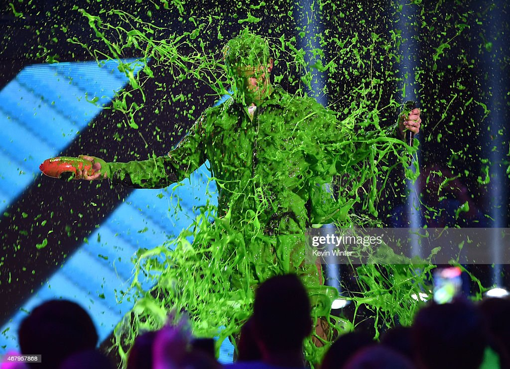 Singer Nick Jonas get slimed while accepting award for Favorite Male Singer onstage during Nickelodeon's 28th Annual Kids' Choice Awards held at The...