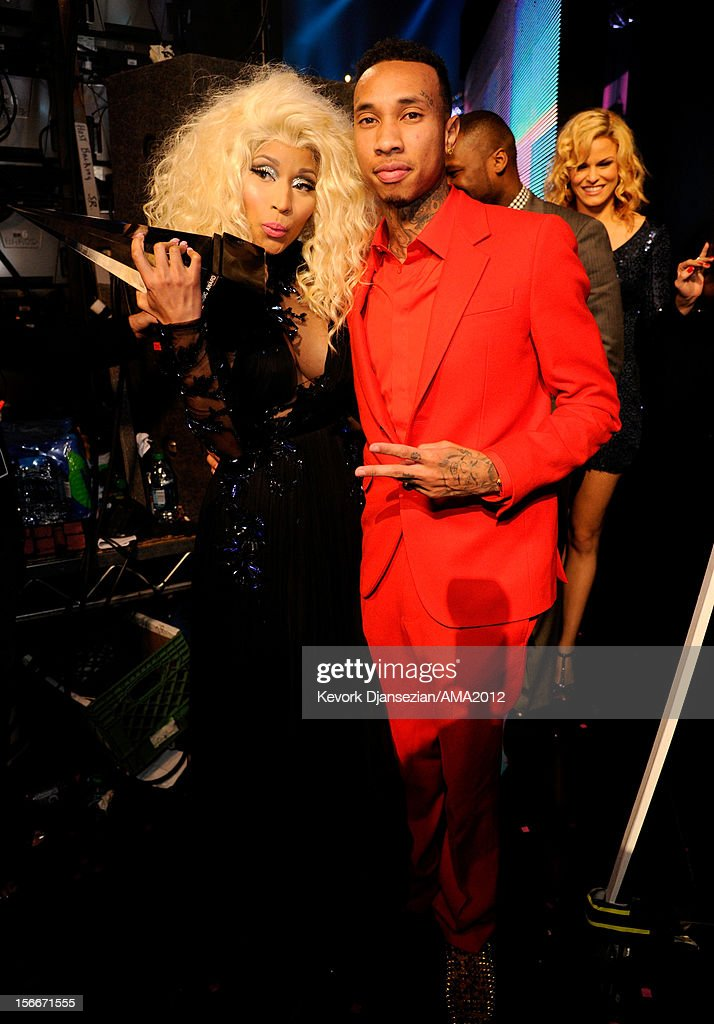 Singer <a gi-track='captionPersonalityLinkClicked' href=/galleries/search?phrase=Nicki+Minaj+-+Artista&family=editorial&specificpeople=6362705 ng-click='$event.stopPropagation()'>Nicki Minaj</a> (L) and rapper <a gi-track='captionPersonalityLinkClicked' href=/galleries/search?phrase=Tyga&family=editorial&specificpeople=4489457 ng-click='$event.stopPropagation()'>Tyga</a> at the 40th American Music Awards held at Nokia Theatre L.A. Live on November 18, 2012 in Los Angeles, California.