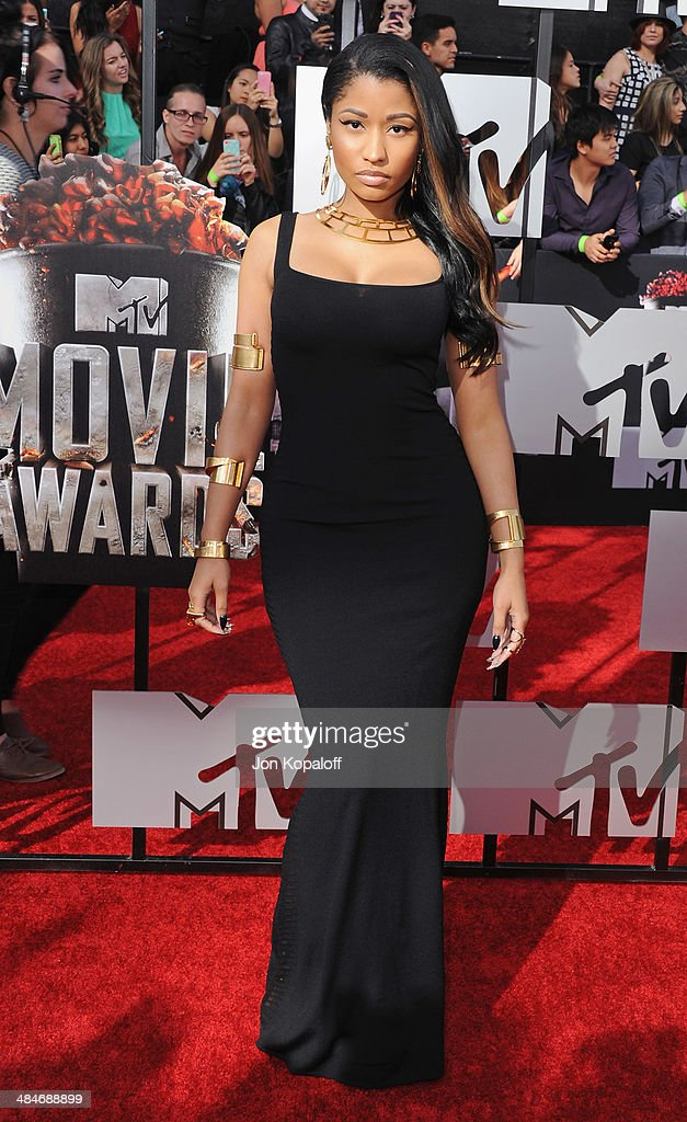 Singer <a gi-track='captionPersonalityLinkClicked' href=/galleries/search?phrase=Nicki+Minaj+-+Performer&family=editorial&specificpeople=6362705 ng-click='$event.stopPropagation()'>Nicki Minaj</a> arrives at the 2014 MTV Movie Awards at Nokia Theatre L.A. Live on April 13, 2014 in Los Angeles, California.