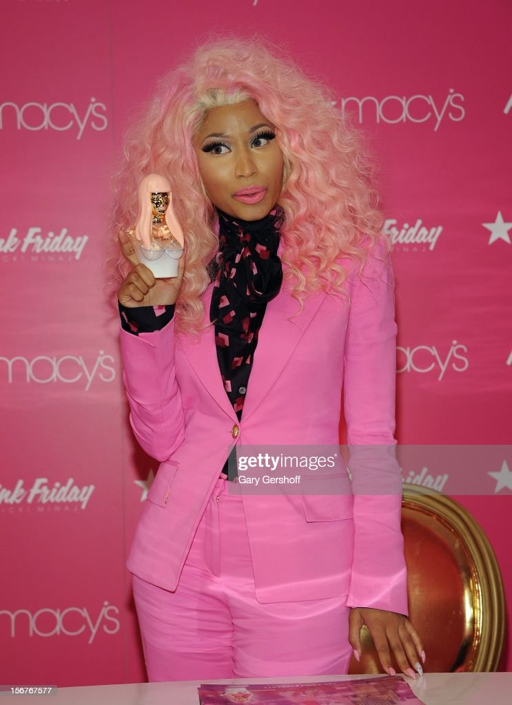 Singer <a gi-track='captionPersonalityLinkClicked' href=/galleries/search?phrase=Nicki+Minaj+-+Artieste&family=editorial&specificpeople=6362705 ng-click='$event.stopPropagation()'>Nicki Minaj</a> attends <a gi-track='captionPersonalityLinkClicked' href=/galleries/search?phrase=Nicki+Minaj+-+Artieste&family=editorial&specificpeople=6362705 ng-click='$event.stopPropagation()'>Nicki Minaj</a>'s 'Pink Friday' Fragrance Holiday Season Celebration at Macy's Queens Center on November 20, 2012 in New York City.