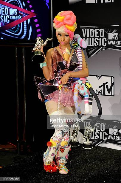 Singer Nicki Minaj winner of the Best HipHop Video Award for 'Super Bass' poses in the press room during the 2011 MTV Video Music Awards at Nokia...