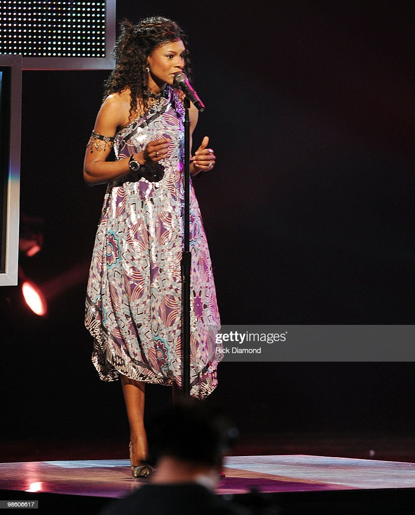 Singer Nicole C. Mullins performs at The 41st Annual GMA Dove Awards at The Grand Ole Opry House on April 21, 2010 in Nashville, Tennessee.