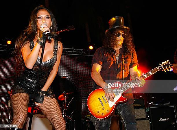 Singer Nicole Scherzinger and guitarist Slash perform during a concert at the Bare Pool Lounge at The Mirage Hotel Casino to celebrate the resort's...