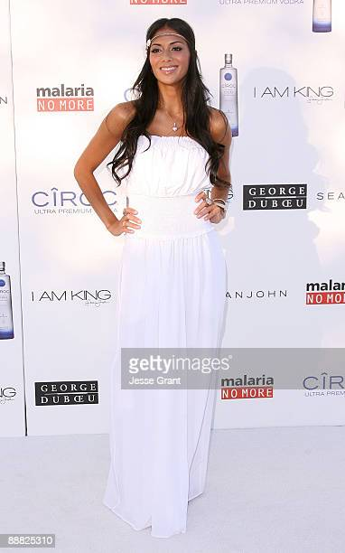 Singer Nicole Scherzinger arrives at the White Party hosted by Sean 'Diddy' Combs and Ashton Kutcher to help raise awareness for Malaria No More held...