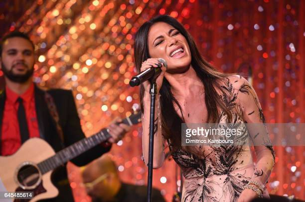 Singer Nicole Scherzinger performs onstage at The Weinstein Company's PreOscar Dinner in partnership with Bvlgari and Grey Goose at Montage Beverly...