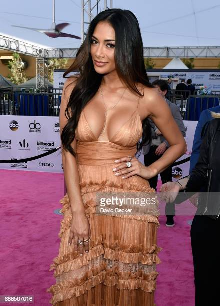 Singer Nicole Scherzinger poses at SiriusXM's 'Hits 1 in Hollywood' red carpet broadcast on SiriusXM's SiriusXM Hits 1 channel before the Billboard...