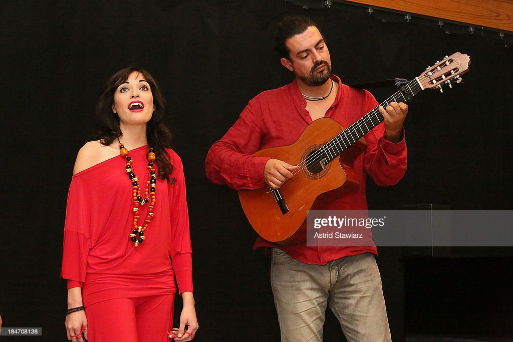 Singer Nicoletta Battelli and guitarist Gianni Migliaccio perform during the 'Voices Of Italy' press preview on October 15, 2013 in New York, United States.
