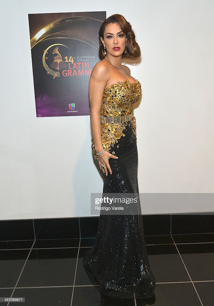 Singer <a gi-track='captionPersonalityLinkClicked' href=/galleries/search?phrase=Ninel+Conde&family=editorial&specificpeople=748464 ng-click='$event.stopPropagation()'>Ninel Conde</a> attends The 14th Annual Latin GRAMMY Awards at the Mandalay Bay Events Center on November 21, 2013 in Las Vegas, Nevada.