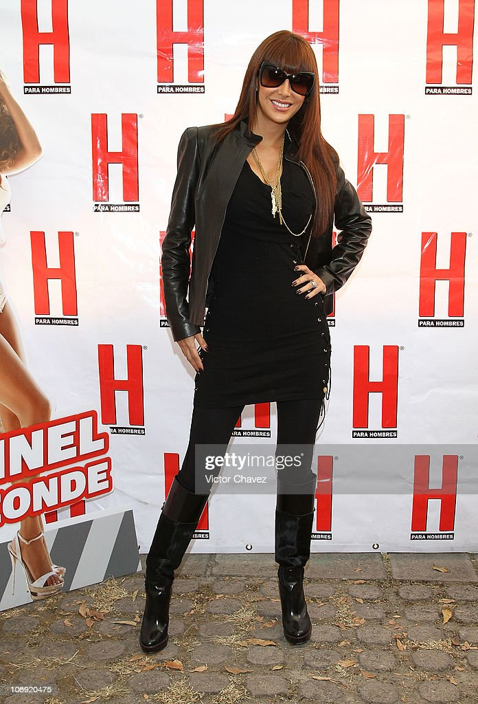 Singer Ninel Conde poses for photographers before she signs copies of her cover of 'H Para Hombres' magazine at Plaza Cuicuilco on November 16, 2010 in Mexico City, Mexico.