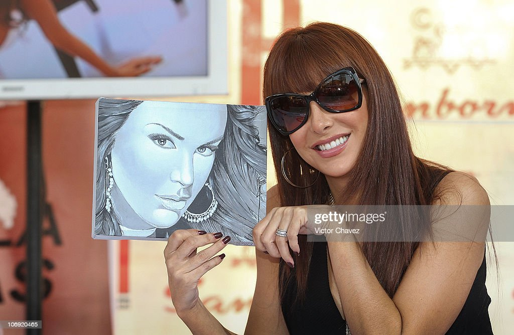 Singer <a gi-track='captionPersonalityLinkClicked' href=/galleries/search?phrase=Ninel+Conde&family=editorial&specificpeople=748464 ng-click='$event.stopPropagation()'>Ninel Conde</a> signs copies of her cover of 'H Para Hombres' magazine at Plaza Cuicuilco on November 16, 2010 in Mexico City, Mexico.