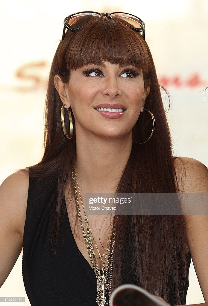 Singer Ninel Conde signs copies of her cover of 'H Para Hombres' magazine at Plaza Cuicuilco on November 16, 2010 in Mexico City, Mexico.