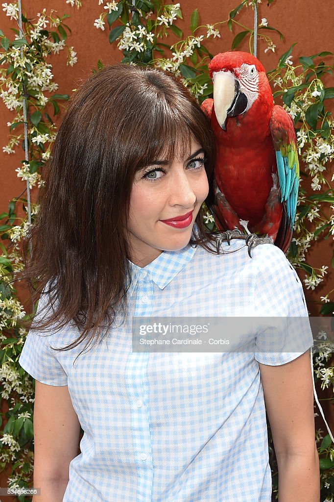 Singer <a gi-track='captionPersonalityLinkClicked' href=/galleries/search?phrase=Nolwenn+Leroy&family=editorial&specificpeople=4343653 ng-click='$event.stopPropagation()'>Nolwenn Leroy</a> and parrot Arthur attend day six of the 2016 French Open at Roland Garros on May 27, 2016 in Paris, France.