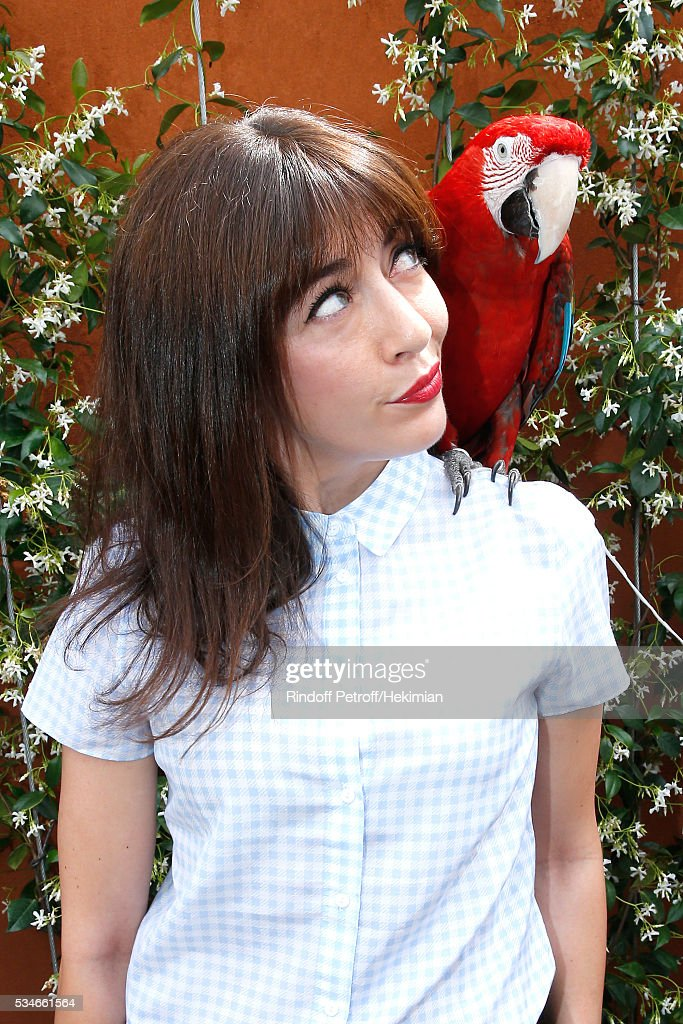 Singer <a gi-track='captionPersonalityLinkClicked' href=/galleries/search?phrase=Nolwenn+Leroy&family=editorial&specificpeople=4343653 ng-click='$event.stopPropagation()'>Nolwenn Leroy</a> and parrot Arthur attend the 2016 French Tennis Open - Day Six at Roland Garros on May 27, 2016 in Paris, France.