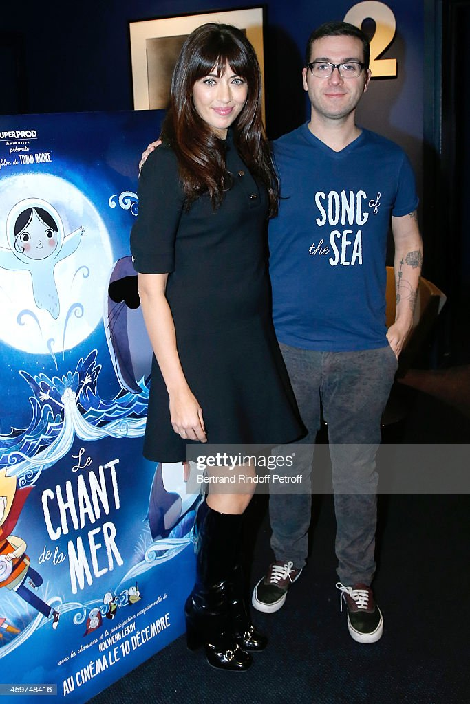 Singer <a gi-track='captionPersonalityLinkClicked' href=/galleries/search?phrase=Nolwenn+Leroy&family=editorial&specificpeople=4343653 ng-click='$event.stopPropagation()'>Nolwenn Leroy</a>, wearing a Gucci dress, is the Mother's voice and sings 2 songs in the movie and Director <a gi-track='captionPersonalityLinkClicked' href=/galleries/search?phrase=Tomm+Moore+-+Illustrator+-+Born+1977&family=editorial&specificpeople=6727666 ng-click='$event.stopPropagation()'>Tomm Moore</a> attend the 'Le Chant de la Mer' (Song of the Sea) : Paris Photocall at Cinema UGC Normandie on November 30, 2014 in Paris, France.
