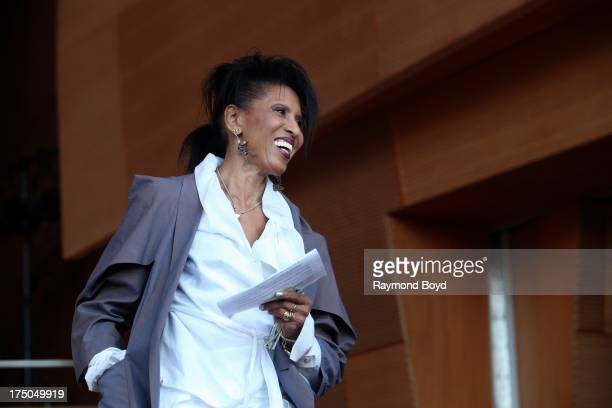 Singer Nona Hendryx prepares to bring on Chaka Khan during Chaka's '40th Anniversary 60th Birthday' concert at the Jay Pritzker Pavilion in Chicago...
