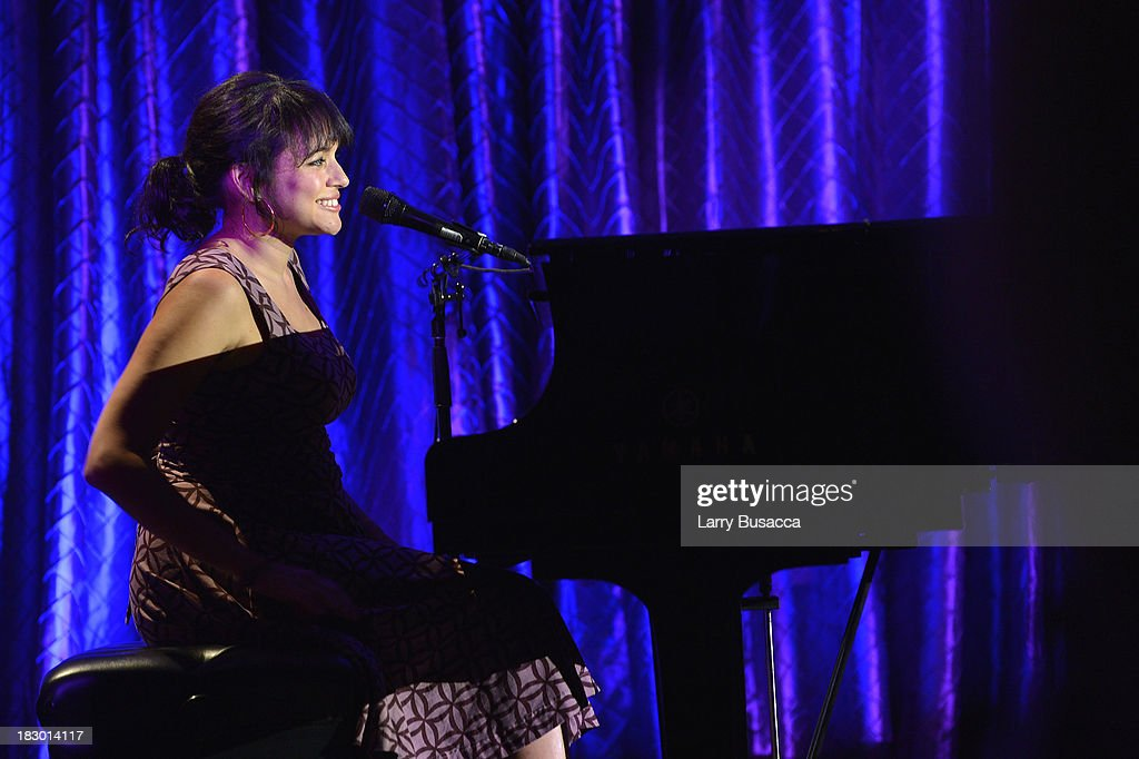 Singer <a gi-track='captionPersonalityLinkClicked' href=/galleries/search?phrase=Norah+Jones&family=editorial&specificpeople=203151 ng-click='$event.stopPropagation()'>Norah Jones</a> performs onstage at the USC Shoah Foundation Institute 2013 Ambassadors for Humanity gala at the American Museum of Natural History on October 3, 2013 in New York, New York.