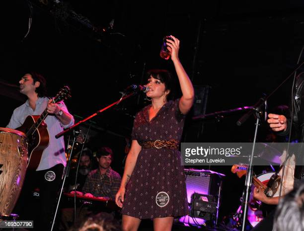Singer Norah Jones toasts the crowd at Jameson Stones Fest NYC at Bowery Ballroom on May 22 2013 in New York City