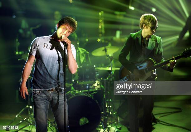 Singer of Norwegian pop trio AHa Morten Harket performs beside Pal WaaktaarSavoy at a dancing competition show on TV station RTL with German...