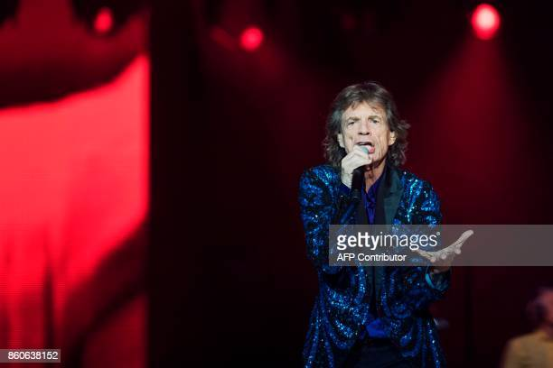 Singer of the band The Rolling Stones Mick Jagger performs on stage at the Friends Arena in Stockholm Sweden on October 12 2017 News Agency / Stina...