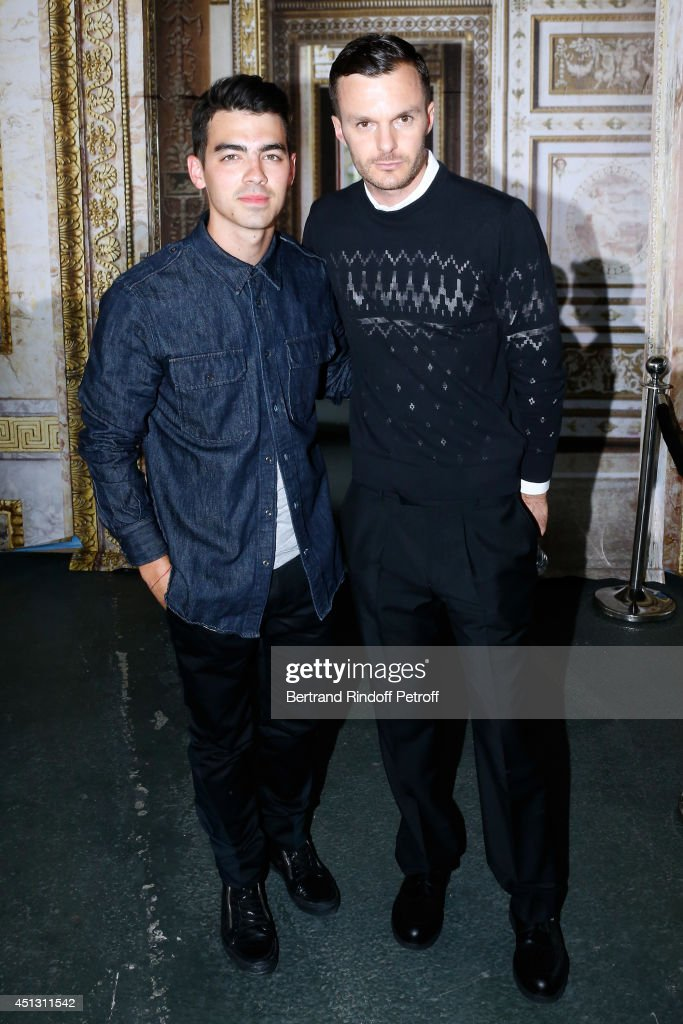 Singer of the 'Jonas Band' <a gi-track='captionPersonalityLinkClicked' href=/galleries/search?phrase=Joe+Jonas&family=editorial&specificpeople=842712 ng-click='$event.stopPropagation()'>Joe Jonas</a> and Fashion Designer <a gi-track='captionPersonalityLinkClicked' href=/galleries/search?phrase=Kris+Van+Assche+-+Fashion+Designer&family=editorial&specificpeople=5744788 ng-click='$event.stopPropagation()'>Kris Van Assche</a> pose after the Krisvanassche show as part of the Paris Fashion Week Menswear Spring/Summer 2015. Held at 'La Halle Freyssinet' on June 27, 2014 in Paris, France.