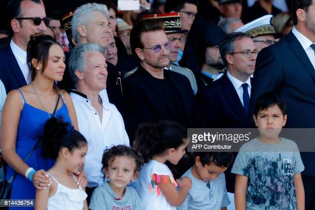 Singer of U2 Bono looks on as he attends a ceremony in Nice southern France on July 14 during a one year anniversary commemerations since a jihadist...