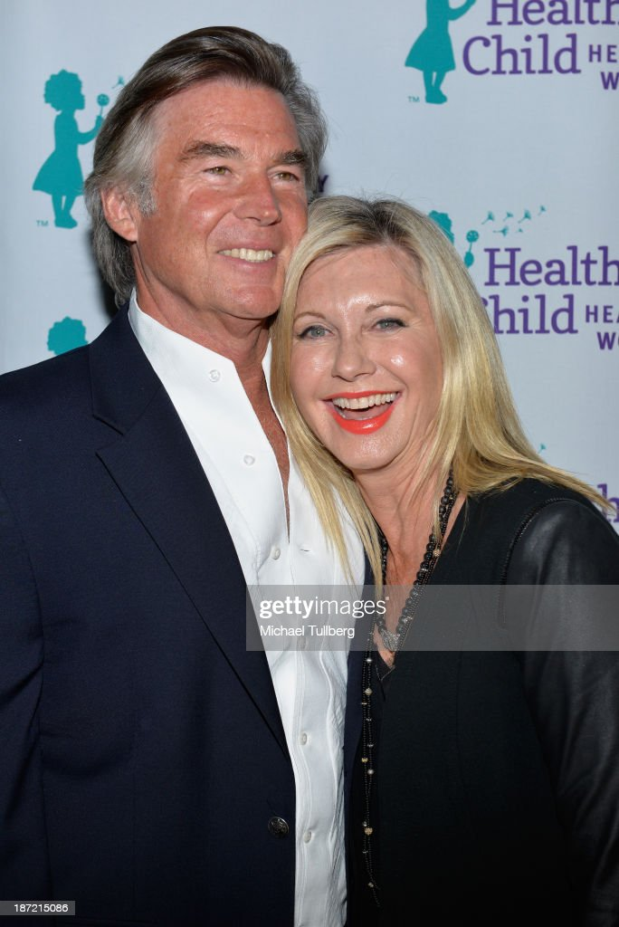 Singer Olivia Newton-John (R) and husband John Easterling attend Mom On A Mission's 5th Annual Awards and Gala on November 6, 2013 in Pacific Palisades, California.