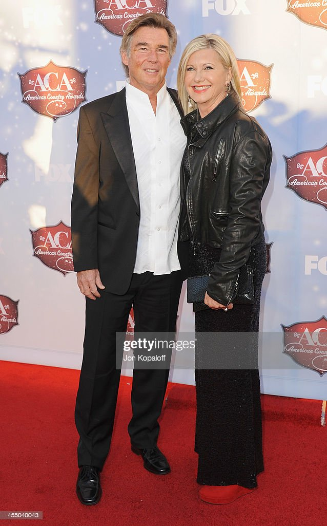 Singer Olivia Newton-John and John Easterling arrive at the American Country Awards 2013 at the Mandalay Bay Events Center on December 10, 2013 in Las Vegas, Nevada.