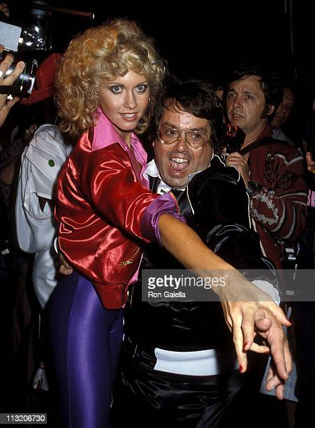 Singer Olivia NewtonJohn and producer Allan Carr attend the 'Grease' Premiere Party on June 13 1978 at Studio 54 in New York City