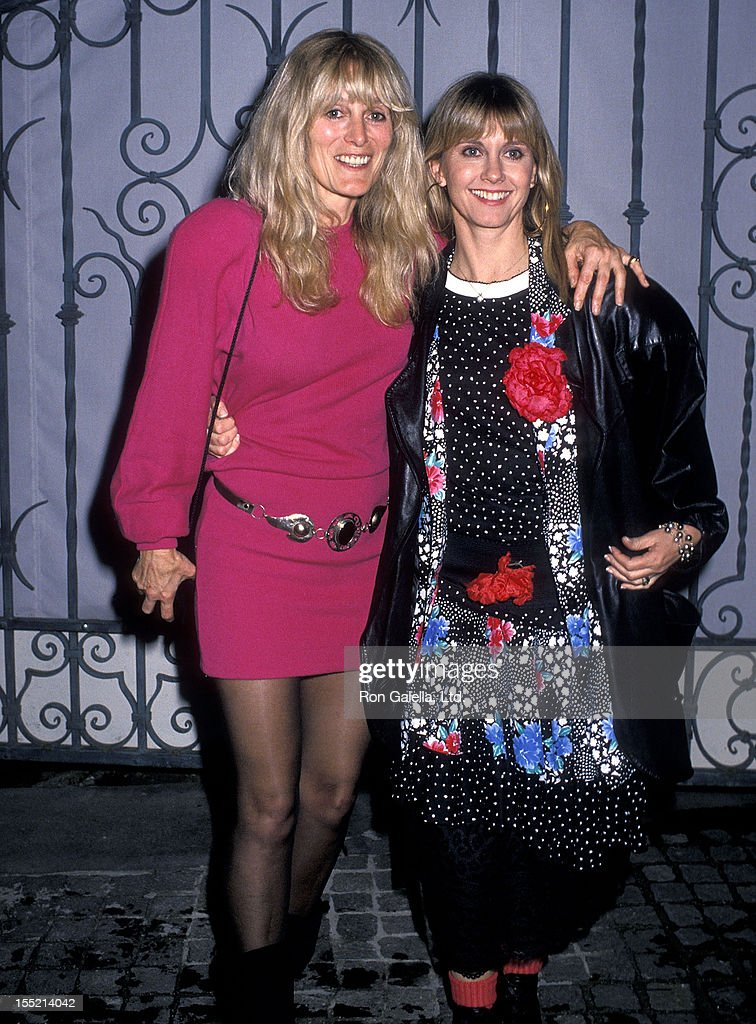 Singer Olivia Newton-John and sister Rona Newton-John attend Sandy Gallin's Holiday Bash on December 18, 1988 at Sandy Gallin's Home in Beverly Hills, California.