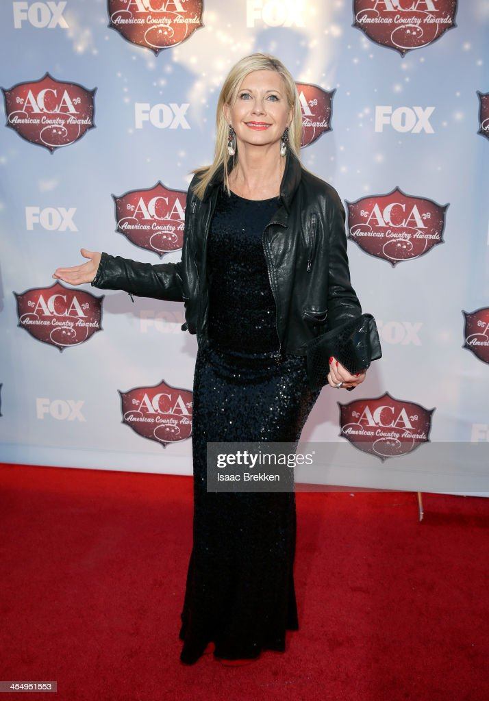 Singer Olivia Newton-John arrives at the American Country Awards 2013 at the Mandalay Bay Events Center on December 10, 2013 in Las Vegas, Nevada.
