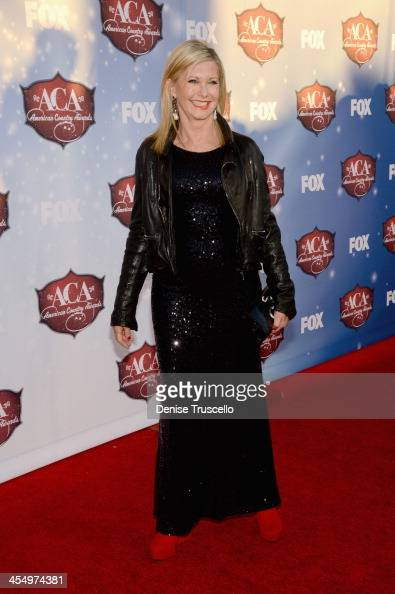Singer Olivia NewtonJohn arrives at the American Country Awards 2013 at the Mandalay Bay Events Center on December 10 2013 in Las Vegas Nevada