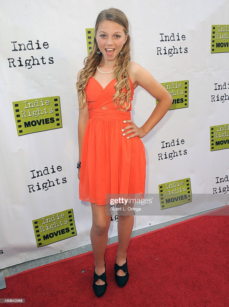 Singer Olivia Ooms arrives for the Premiere Of 'The World Famous Kid Detective' held at The Arena Theater on June 14, 2014 in Hollywood, California.